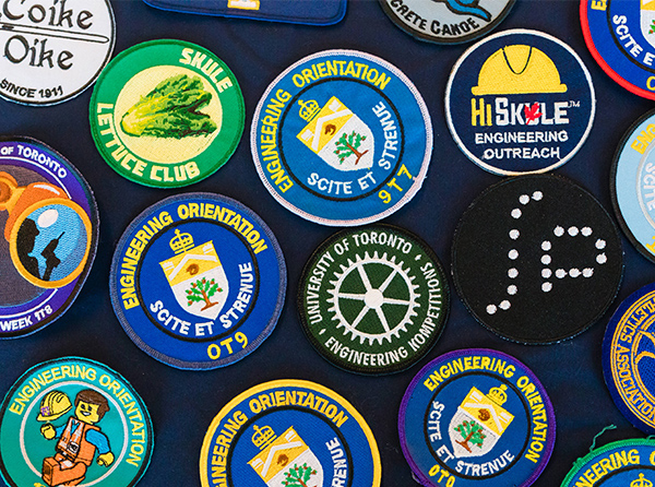 colourful Skule badges representing student groups